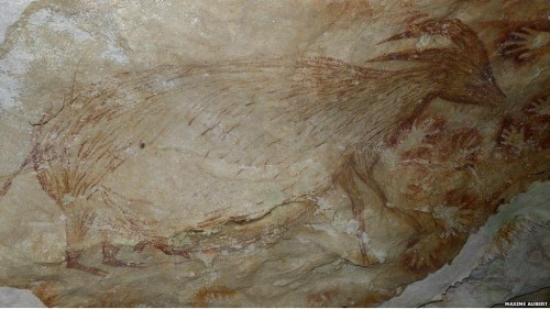 Painting of a dwarf water buffalo and stencils of human hands from a cave in SW Sulawesi (credit: Maxim Aubert, Griffith University, Australia)