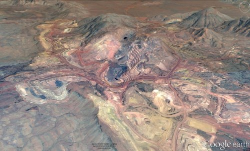 Oblique view of an open pit mine in banded iron formation at Mount Tom Price, Hamersley region Western Australia (Credit Google earth)