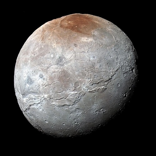 Charon imaged in approximately natural colour by New Horizons. (credit: NASA)