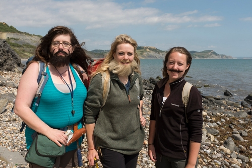 Three of the presenters in the Bearded Lady project pose on the foreshore at Lyme Regis - note Golden Cap in the background. (Credit: Kelsey Vance)